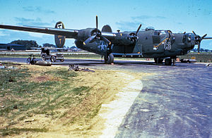 "RAF Eye - Ground personnel of the 490th Bomb Group work on a B-24 Liberator (serial number 42-94837 ) nicknamed ""The Jinx 13"" at Eye."