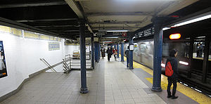 Lexington Avenue/59th Street (New York City Subway) - An uptown 6 train of R142A cars enters on the local platform