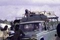 "ASC Leiden - F. van der Kraaij Collection - 02 - 015 - Black men carrying white sacks ""MgO"" from the Firestone Harbel Plantation - Montserrado County, Liberia, 1977.tiff"