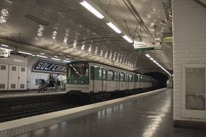 Paris Métro Line 12 - An MF 67 stock train arriving at Solferino