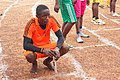 A Male Athlete. Senior male student as he prepares for a 400 meters relay race.jpg