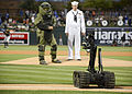 A Talon bomb disposal robot brings out the ball for the first pitch at a spring training baseball game. (26068020156).jpg