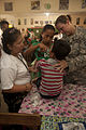 A U.S. Army doctor, right, and an Armed Forces of the Philippines doctor, left, assist a boy who passed out during a medical civic action program at the Amungan Elementary School in Amungan, Zambales province 130407-M-UY788-039.jpg