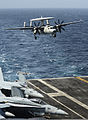 A U.S. Navy E-2C Hawkeye aircraft assigned to Airborne Early Warning Squadron (VAW) 115 prepares to land aboard the aircraft carrier USS Nimitz (CVN 68) in the South China Sea Nov. 22, 2013 131122-N-TW634-335.jpg