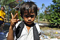 A boy at Otres Primary School stands for a photo Dec. 16, 2011, as U.S. Sailors and Marines participate in a community service project at the school in Sihanoukville, Cambodia 111216-N-KS651-377.jpg