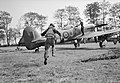 A pilot of No. 175 Squadron RAF scrambles to his waiting Hawker Typhoon Mk IB fighter-bomber at Le Fresne-Camilly in Normandy, 24 July 1944. CL570.jpg