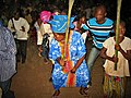 A woman dancing at Torchlight walk on the eve of a youth forum in Dangbo, Benin . seen in 2009.jpg