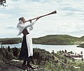 A young Swedish women playing a birch trumpet around 1930 (cropped).jpg