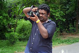 Abdullah Al Durrani Sony taking photo on Wikipedia Photowalk at University of Chittagong (01).jpg