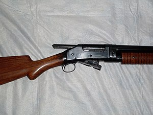Winchester Model 1897 - Open action on an 1897 portraying the long slide that projects from the receiver.