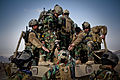 Afghan soldiers give a hand up to a fellow soldier after a training exercise at Forward Operating Base Scorpion in Kabul province, Afghanistan 130223-A-NH731-213.jpg