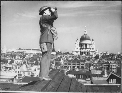 Aircraft spotter on the roof of a building in London with Saint Paul's Cathedral in the background. New York Times... - NARA - 541900.tif