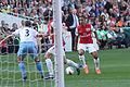 Alex McLeish admires Theo Walcotts skills (7013690215).jpg