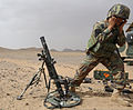 An Afghan National Army commando with the 1st Tolai, 3rd Special Operations Kandak fires a mortar round during a training exercise in the Dand district, Kandahar province, Afghanistan, May 25, 2013 130525-A-QS703-119.jpg
