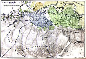 Antakya - Densely built Antakya in 1912: the traditional Muslim city shows no trace of its Hellenistic planning. To the east, orchards (green) fill the plain.