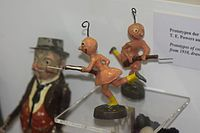 Antique toy aliens armed with WWI bayonets (25276050249).jpg