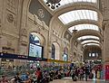 Arrivals hall, Milano Centrale station, angled view wide.jpg