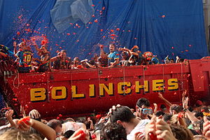 La Tomatina - Throwing tomatoes from a truck.