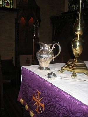Asperges - An aspergillum (sprinkler) and silver ewer of holy water on the altar, prepared for asperges (Cathedral Church of Saint Matthew, Dallas, Texas).