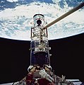 Astronauts Jeffrey Hoffman and Story Musgrave with Wide Field Camera during the Third STS-61 Extravehicular Activity (28051112341).jpg