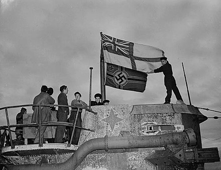 Seamen raise the White Ensign over a captured German U-boat U-190 in St. John's, Newfoundland 1945 Atlanticflagsub.jpg