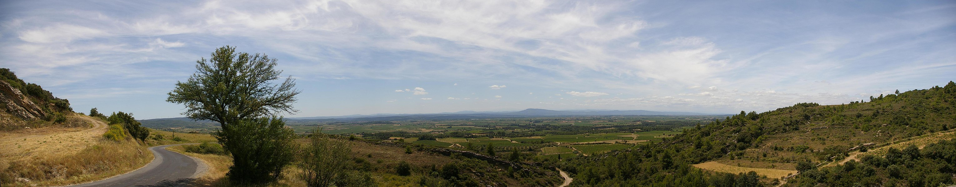 Panoramic view of the Aude valley, looking south, taken from a promontory just north of Cesseras, near Minerve, about 30 kms east of Carcassonne. Individual pictures made into a panoramic using AutoStitch. Geodata is slightly approximate but not off by more than a few hundred metres.