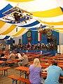Augsb Jak Kirchweih Platz im Festzelt.jpg