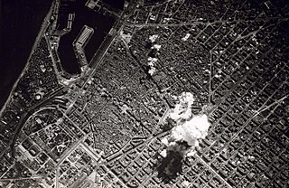 Carpet bombing aerial bombing done on a massive scale to damage every part of a selected area