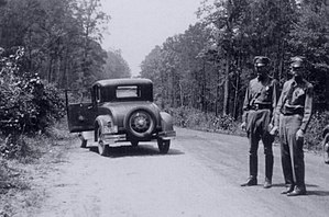 Frank Hamer - Desolate road deep in the piney woods: the trail for Bonnie and Clyde ended here.