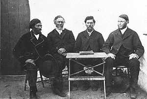 Baster - The first council of the Rehoboth Basters, 1872. First Kaptein Hermanus van Wyk is the third from left; the book on the table is the Vaderlike Wette, the constitution of the Basters