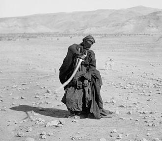Sword dance - A Bedouin woman performing a sword dance, c. 1910