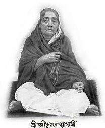 A Bengali woman , sitting