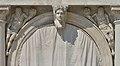 Biblioteca marciana Venezia arco della facciata figure maschili con cornucopia.jpg
