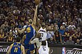 Bogut and Thompson tip off.jpg