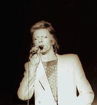 Diamond Dogs Tour - Bowie performing at the Charlotte Coliseum in Charlotte, North Carolina on 5 July  1974