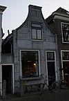foto van Huis met gepleisterde tuitgevel