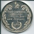 British Empire Games 1950 - E Smith Silver Medal.jpg