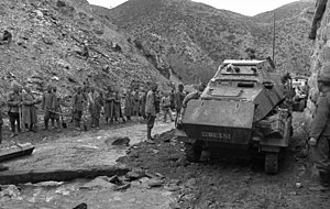 World War II in Yugoslavia - Yugoslav POWs supervised by Bulgarian soldiers and German armored car.