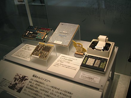 On the left, the NEC TK-80 kit, based on Intel 8080 chip, on the centre, Busicom calculator motherboard, based on Intel 4004 chip, and on the right, the Busicom calculator, fully assembled in Ueno, Tokyo Busicom.JPG
