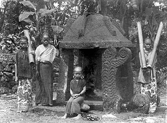South Nias Regency - Girls at an offering house at the entrance of a kampong in South Nias