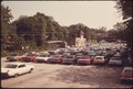 COMMUTER PARKING LOT AT A SOUTHEASTERN TRANSPORTATION AUTHORITY (SEPTA) TRAIN STATION IN THE SUBURBS OF PHILADELPHIA... - NARA - 556773.tif