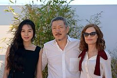 Hong Sang-soo with Kim Min-hee and Isabelle Huppert at the 70th Cannes Film Festival (2017)