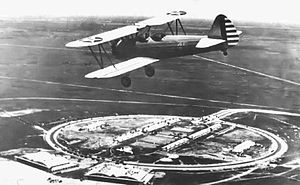 Carlstrom Field - A 1942 photo of a Major George Ola in a PT-17 Stearman biplane trainer over Carlstrom Field