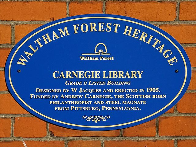Andrew Carnegie and W Jacques blue plaque - Carnegie Library. Grade II Listed building. Designed by W Jacques and erected in 1905. Funded by Andrew Carnegie, the Scottish born philanthropist and steel magnate from Pittsburg, Pennsylvania