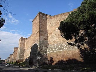Late Roman army - The Aurelian Walls of Rome, built by Aurelian in 270–5. Rome's first new wall since the construction of the Servian Wall after the Gauls sacked Rome 650 years earlier, they symbolised the pervasive insecurity of the 3rd-century empire. Original height: 8m (25 ft). Doubled in 410 to 16m (52 ft) after second sack of Rome in 410. Both walls and towers were originally crenellated, but this has survived only in small sections. Most of the 19km circuit still stands today