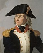 Color print of an angry looking man with a long nose and long hair. He wears a large bicorne hat and a dark blue military coat with white lapels, gold epaulettes and a red collar.