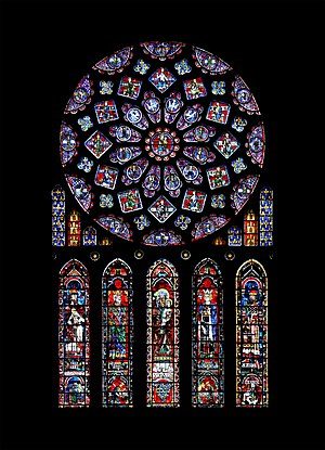 Stained glass - The north transept rose of Chartres Cathedral donated by Blanche of Castile.  It represents the Virgin Mary as Queen of Heaven, surrounded by Biblical kings and prophets.  Below is St Anne, mother of the Virgin, with four righteous leaders.  The window includes the arms of France and Castile.