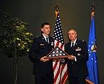 Christopher F. Burne presents a U.S. flag to Lindsey Graham.jpg