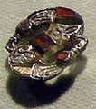 Cividale, man, fibula a S in argento dorato, da necropoli cella 09 con granati almandini.jpg