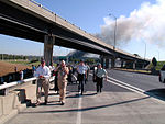 Civilian and Military personnel are evacuated down Interstate highway I-395, following the 9-11 terrorists attack on the Pentagon Building located in Washington, District of Columbia (DC) 010911-N-NT811-005.jpg